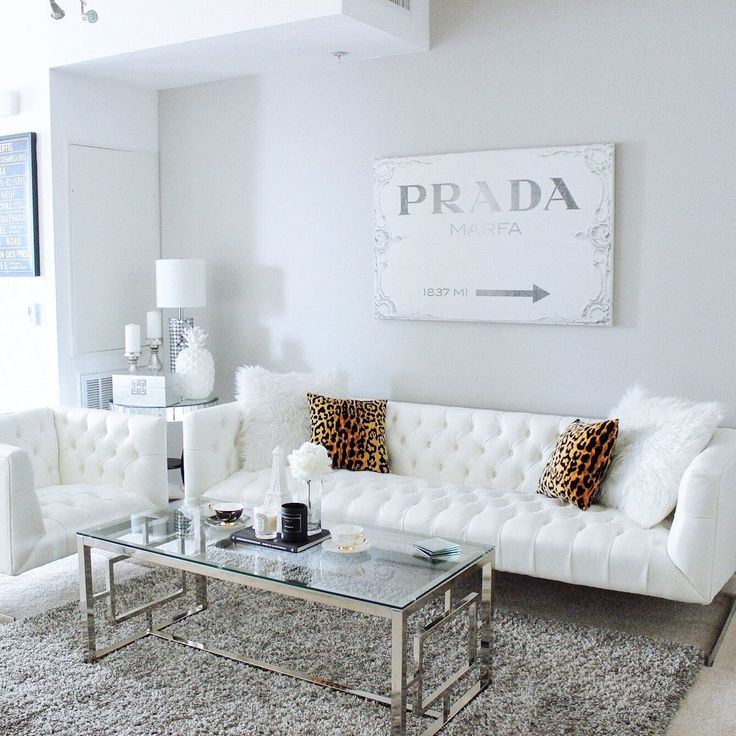 Gray & White Living Room Decor | White Tufted Sofa | Prada Canvas | Living room of Hayley Larue from BlondieintheCity.com