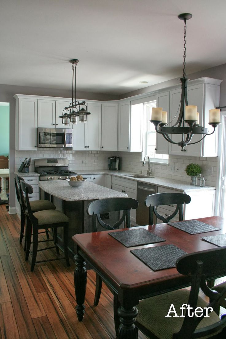 Transitional Kitchen With White Shaker Style Cabinets And Quartz Counter Tops