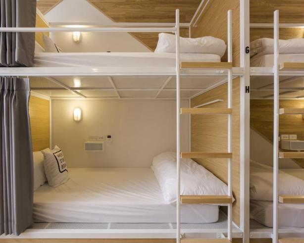 Bed One Block Hostel Design - bunk beds. This slimlined hostel design in Bangkok, Thailand is genius!