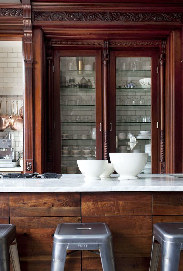 Restored and repurposed brownstone kitchen including original Victorian cabinetry.