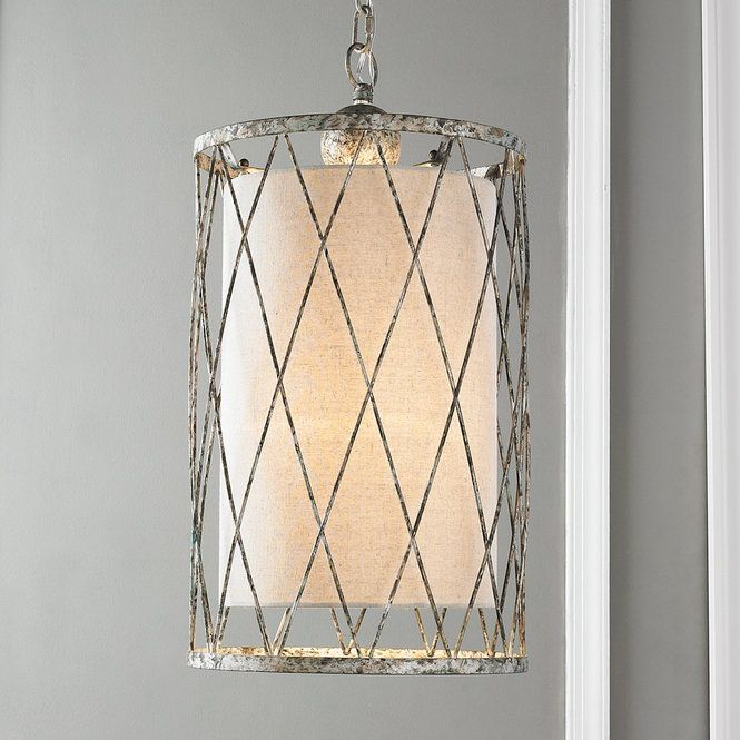 "This transitional style pendant combines garden like lattice with a sleek natural linen shade. The cylindrical open weave body is hand finished in mottled aged silver reminiscent of Old World artifacts. Rustic and refined details combine to create an illuminating fixture to use independently in an entry or bath, or clustered over your kitchen island or dining table. 40 watt max.  ( 25""H x 13""W ). Wire: 6.5' and Chain: 6' $275"