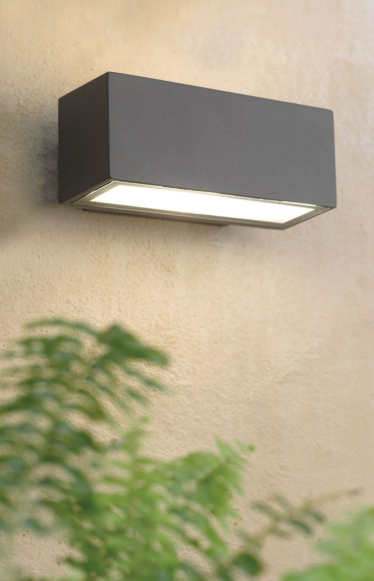 The Beacon Lighting Tucson 1 light exterior up/down wall bracket in charcoal with opal diffuser.