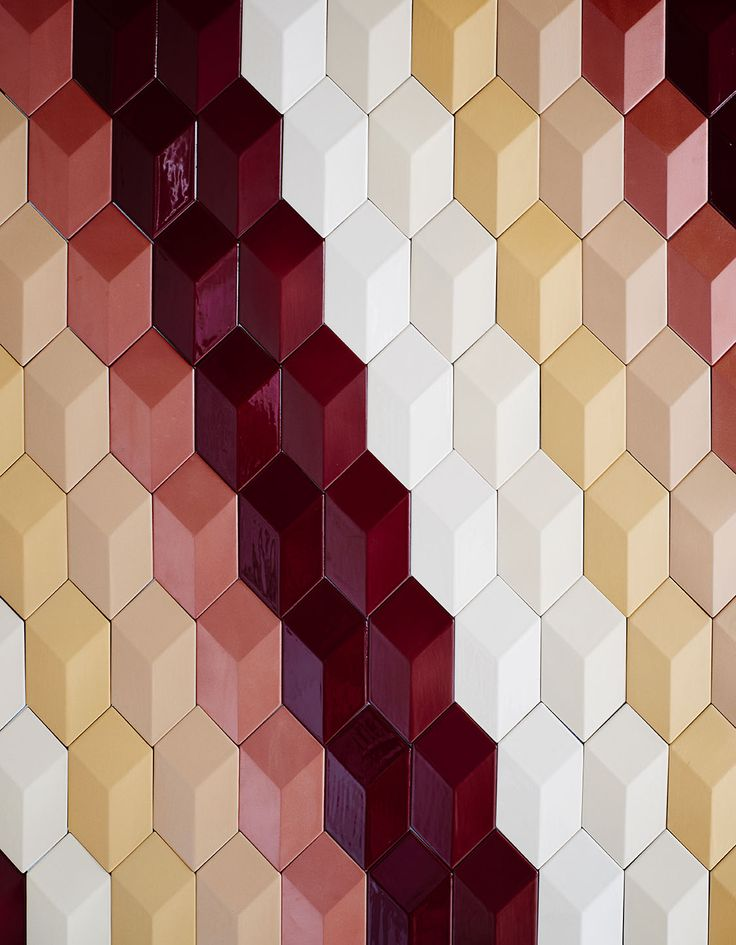 Three dimensional terra-cotta tiles with the shape of a Rombo for walls.