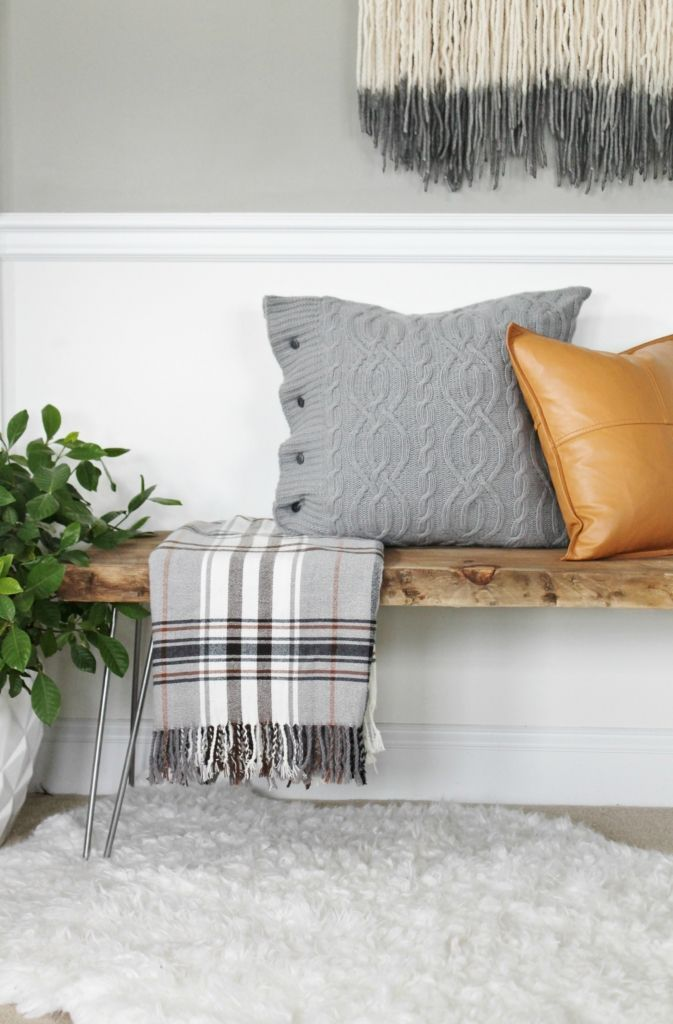 Wooden Bench At Home Entrance Paired With Mixed Textured Throw Pillows And Blanket