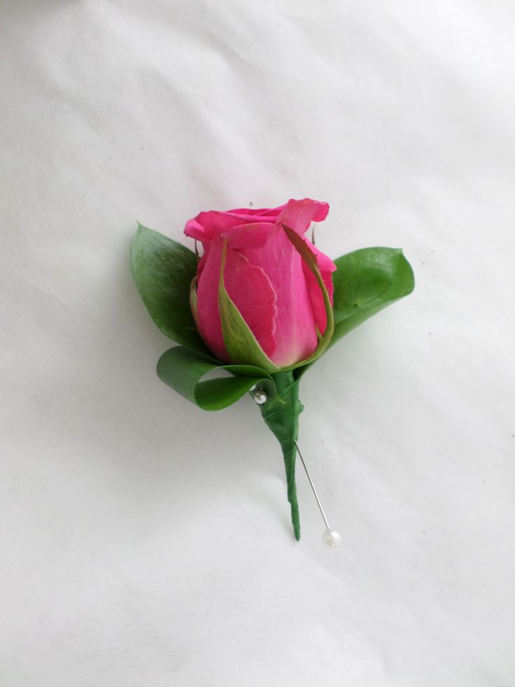 Wedding buttonhole using a pink rose. Created by the team at  http://floristilene.co.nz/