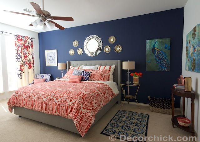 diy navy coral bedroom | Pop of colour on the back wall with a printed bed spread and statement ...