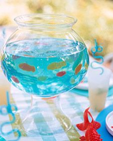 Fish bowl jello with swimming gummy fish for pool party snack!