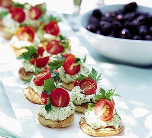 Tomato & feta pesto bites...savory tarts topped with callous of feta pesto, cherry tomato halves and fresh herb
