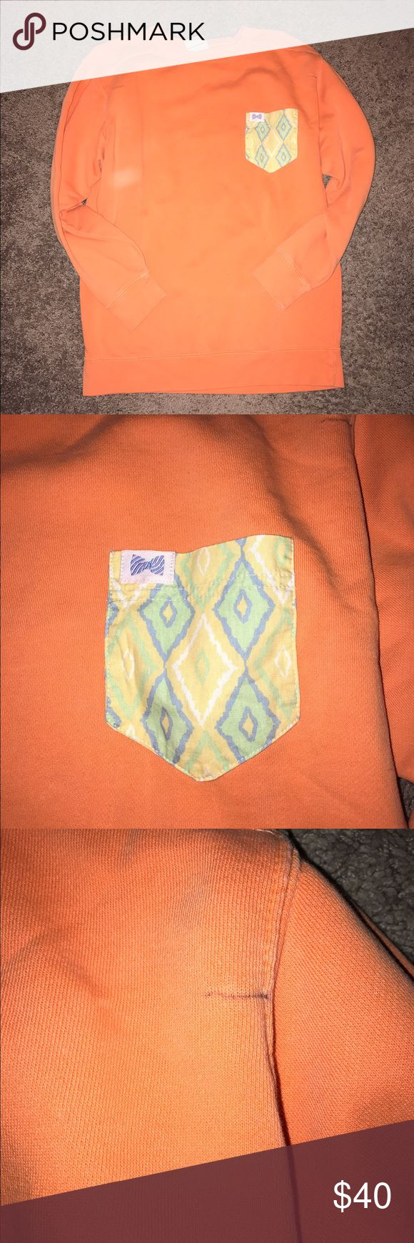 Fraternity Collection pullover Orange pullover Fraternity Collection with yellow, white, blue and green pocket (pastel colors) with the Fraternity Collection bow logo on the pocket (see pictures) *THERE IS A SMALL PEN MARK ON THE TOP LEFT SHOULDER* Please be aware of this if purchased! It's a super cute winter/spring pullover, not too bulky or heavy :) This was only worn a few times, brand new condition besides the small pen mark! Fraternity Collection Sweaters