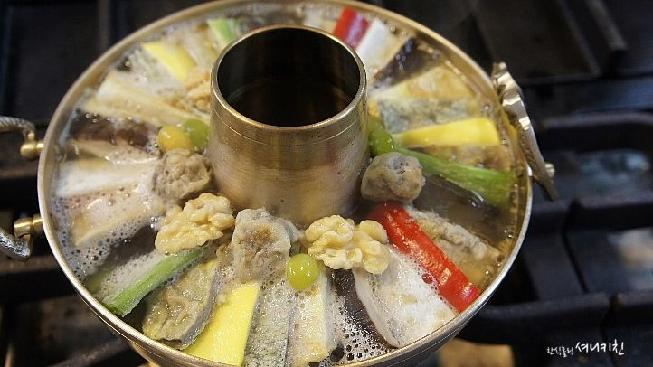 korea tradition food 'a brass chafing dish on food'