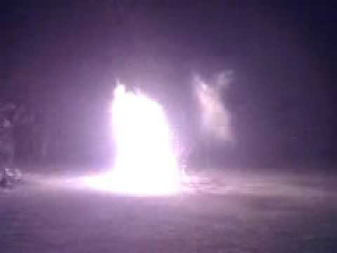 video movie, of moving Real Angel flying hovering over campfire   while Jesus being praised. October 2015