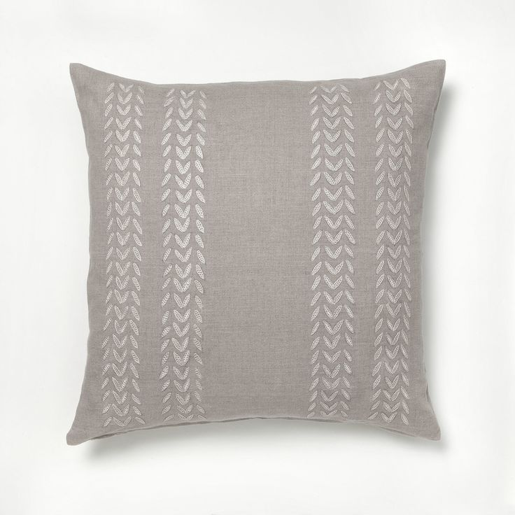 Intricate hand embroidered petal design make this pillow cover a real work of art // more on ARTHA Collections #throwpillows #linenpillows #beigepillows