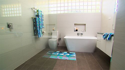 This full bathroom renovation transformed the room into a modern masterpiece. Great interior design with all the latest bathroom products from Highgrove Bathrooms. Frameless Shower Panels with Back to Wall Toilet Suite and Freestanding Bath