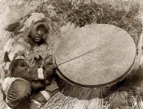 Photo of an Eskimo Drummer. It was made in 1929 by Edward S. Curtis... this is one of the biggest sized qilaut wind drums i have seen.... #frame_drum