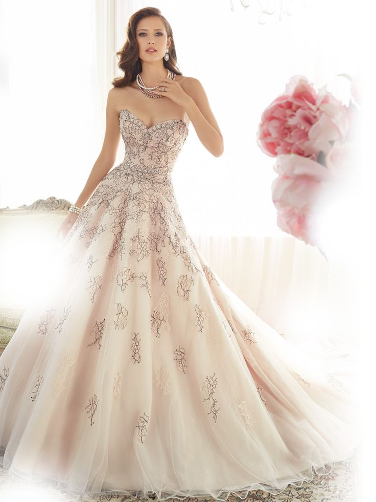 Sophia Tolli | Style No. › Y11576 | Rose pink evokes classic love and ball gown Starling captures just that in lace and misty tulle. Delicate scalloped lace frames the strapless sweetheart neckline with crystal and pearl hand-beading, enhancing the captivating quality of the lace. Hand-placed shadow box lace appliqués adorn the bodice and spill into the romantic voluminous skirt with chapel length [...]