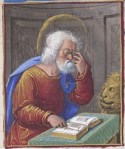 Mark the Evangelist reading and holding spectacles to his eyes, the lion at his…