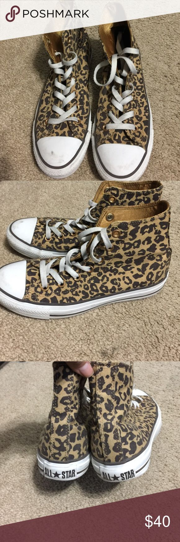 Leopard converse hightops Gently used in pretty good condition. Sizing does run bigger Converse Shoes Athletic Shoes