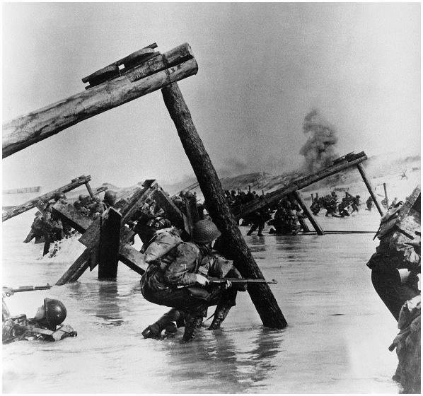 D-Day this just brwaks my heart. Those kids hiding behind a pole. Noplace to hide
