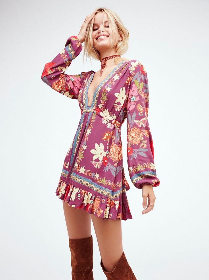Violet Hill Printed Tunic | Floral printed tunic in an effortless silhouette featuring a plunging neckline. Adjustable waist tie and pleat detailing with a ruffle hem. Hidden side zip hem.