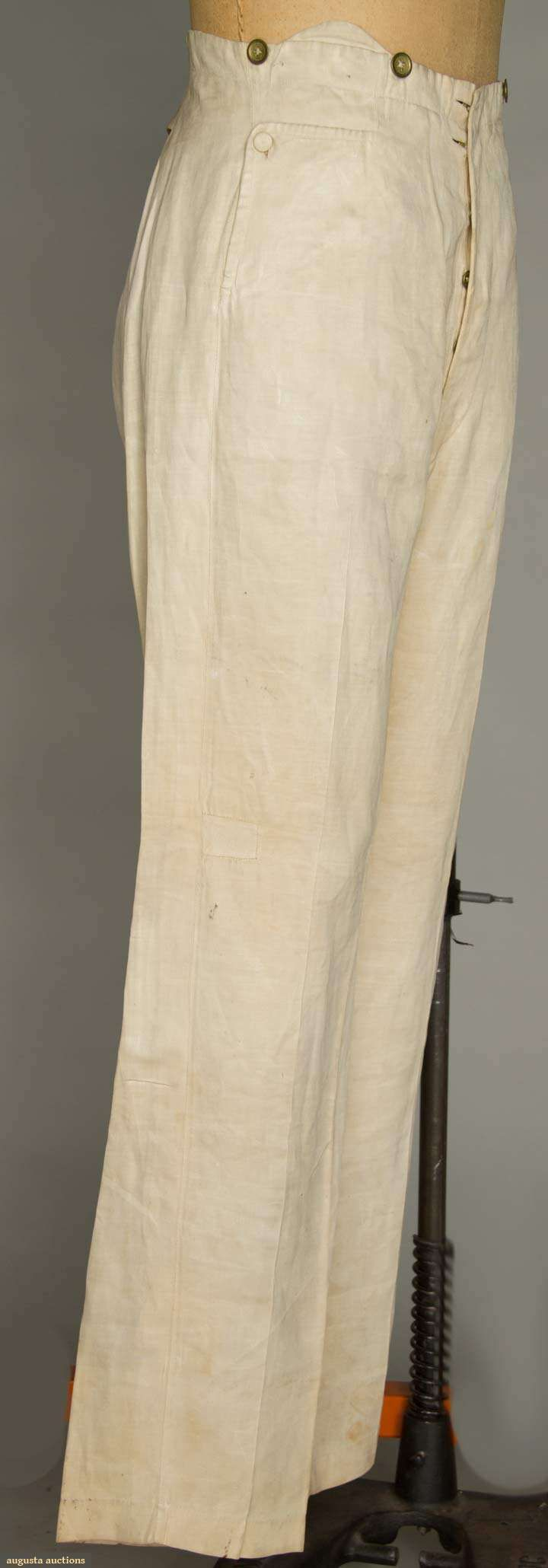 FOUR MEN'S LINEN SUMMER GARMENTS, 1850-1869 1 3/4 coat, 1 large chest pocket & 1 small watch pocket, 2 etched MOP buttons above pleated & vented back skirt, eyelet holes for front buttons; 1 tan vest w/ shallow notched collar, tiny self fabric buttons & muslin back; 2 pair cream satinweave linen pants w/ high pointed back waist & brass buttons at waist & fly: 1 w/ right angle button flap pockets below waist