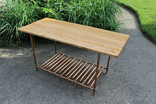 """Reclaimed Oak Flooring & Copper Pipe Coffee Table by Paul Segedin & Urban Prairie Design, Chicago, Illinois.  ~ 19"""" high x 40"""" wide x 18"""" deep. Table is made with reclaimed oak flooring from Reuse Depot in Maywood, Illinois and with construction grade copper pipe. Available for $375."""