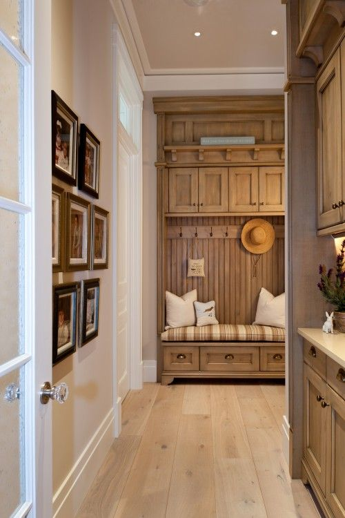 love the finish on these laundry room cabinets - easy to keep clean would look good with black appliances
