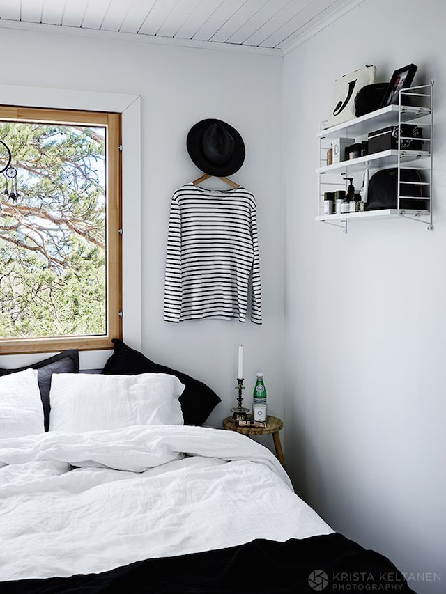 Monochrome bedroom in an idyllic Finnish cabin in the Inkoo archipelago. Photo…