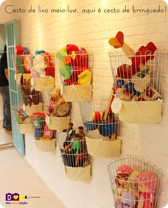 Line play room walls with cheap wire trash cans for toy storage