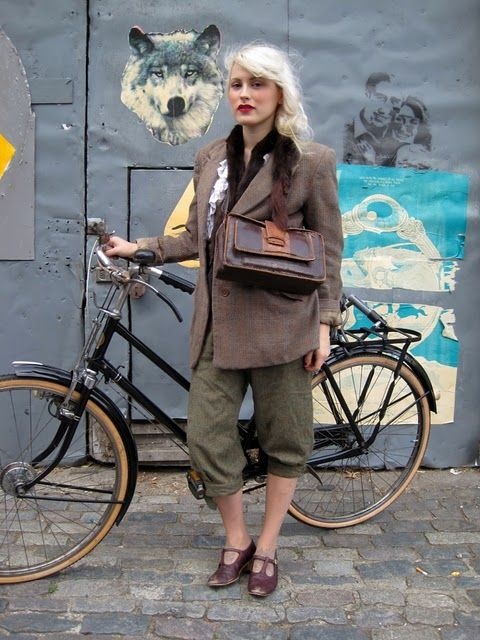 Stunningly cool girl with a bike.