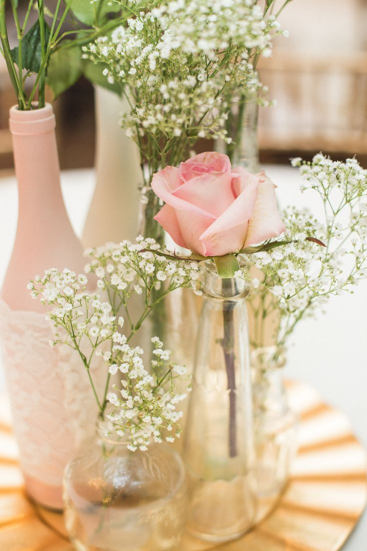 DIY Centerpiece, blush roses, gold charger, painted wine bottles.