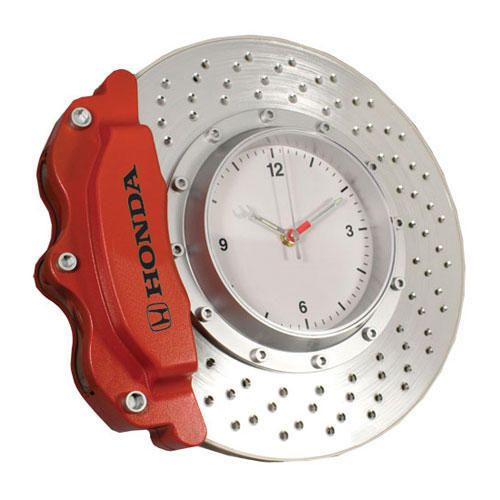 """Brake Disc Clock. 13"""" diameter wall clock with red caliper on silver rotor. Wrench shaped sweeping hands. Battery operated. Honda logo printed in black on caliper."""