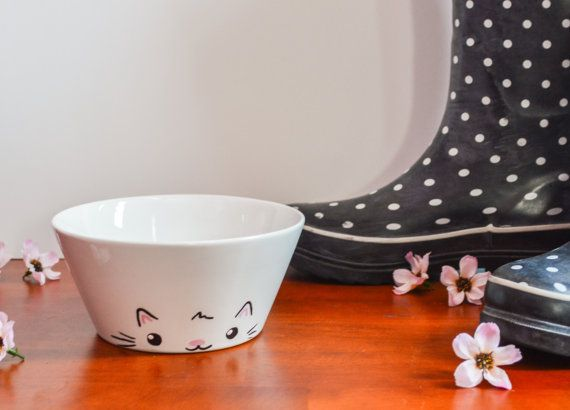 This is a white ceramic bowl featuring a cute cat face on the front and a cats tail on the back. This is a tapered bowl. It holds 18 oz. and has a diameter of 6 inches. If you select a custom color, please let me know what color you want when ordering! This is a great gift for the cat lover in your life!  This bowl was actually suggested to me by one of my awesome customers! She had purchased the cat mug as a Christmas gift and then e-mailed me asking for a matching bowl. It came out so…
