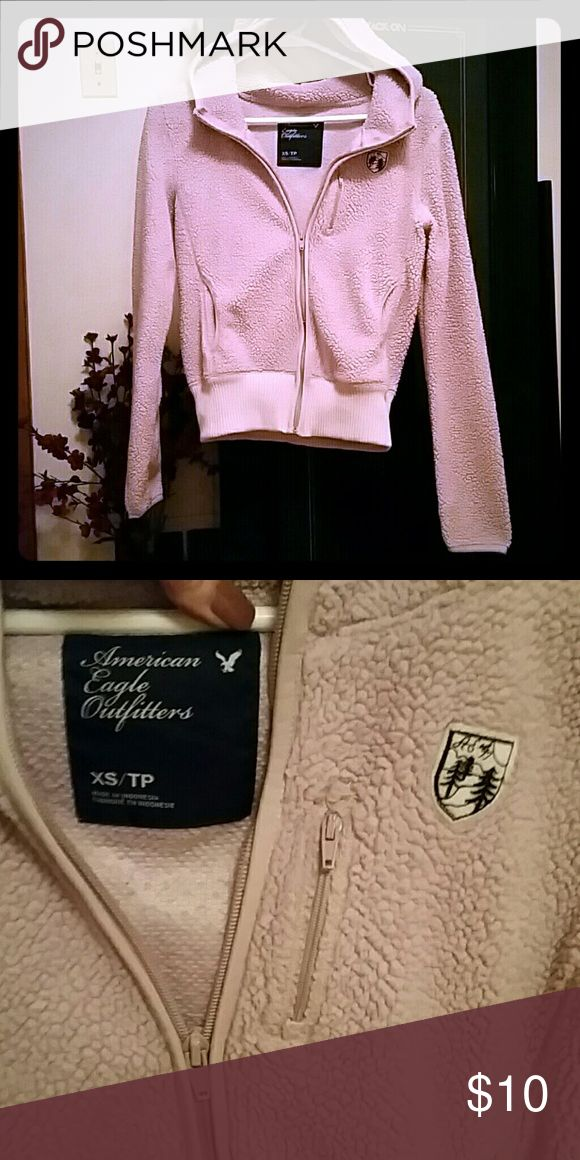 American Eagle Zip Up Hoodie Fuzzy, warm, blush colored jacket by AE.  Preloved, but was just washed and ready to be worn.  Very petite. American Eagle Outfitters Tops Sweatshirts & Hoodies