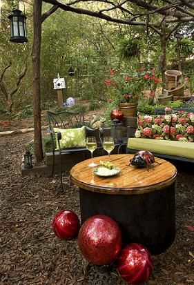 this award winning outdoor space was created by recycling fallen trees recycled, gardening, outdoor living, repurposing upcycling, Old Well cover coverted to a fire pit with removeable table top