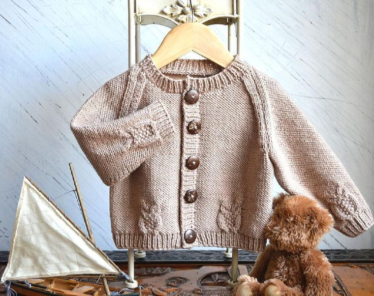 Round neck raglan sleeve cardi with cabled owls - P079 Knitting pattern by OGE Knitwear Designs
