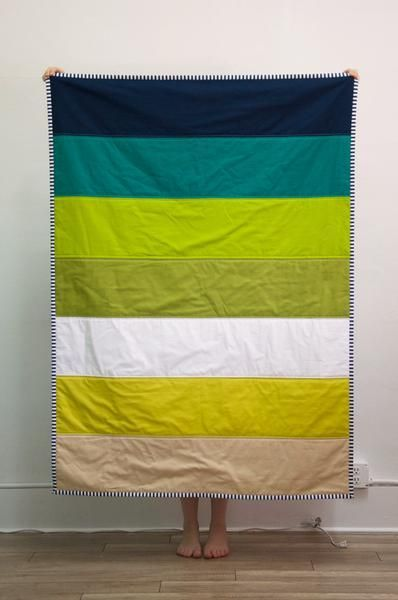 """• a gorgeous, modern color block quilt with seven different colors • a well-sized quilt that isn't just for babies - it's large enough to be an adult sized throw blanket at 42"""" x 62"""" • an heirloom qua"""