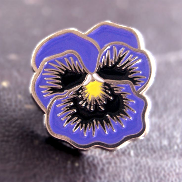 """For all the horticulturalists and proud pansies out there.    Soft enamel, 3/4"""", black rubber clasp"""