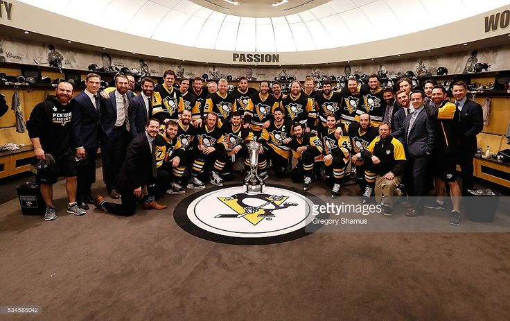 Pittsburgh Penguins celebrate by holding the Prince of Wales Trophy