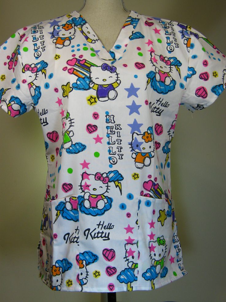 #caringplus scrub top -Hello Kitty White- CaringPlus scrubs and uniforms - workwear clothing for nurses, caregivers and other healthcare professionals. Perfect apparel for doctor, dental and optician offices, nursing homes, rehab centers, vet clinics, animal hospitals, or medical labs.