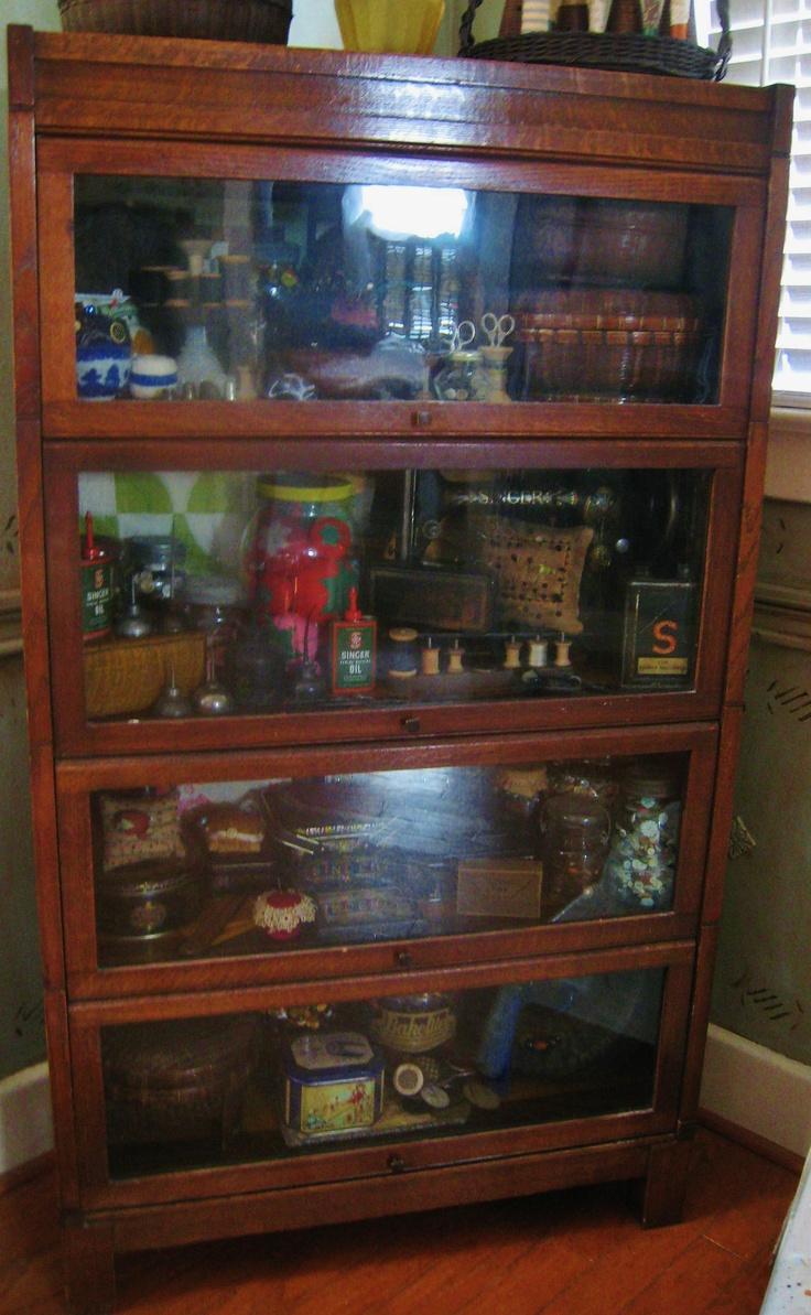 I love cabinets like this! I'm thinking fabric storage.