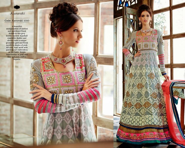 A beautiful amalgamation of zardosi and multihued floral details in this grey double layered 'Anarkali' ensemble. Bodice and sleeves have a unique geometric grid and floral motifs in shades of pink. All over 'Aari' work with patched zari embroidery on the 'kalis'. Bright hued border in pink and blue and pink chiffon dupatta.