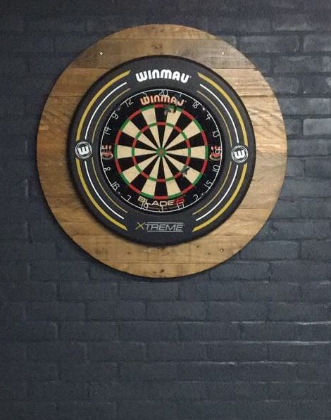 Dartboard surround made from varnished pallet boards