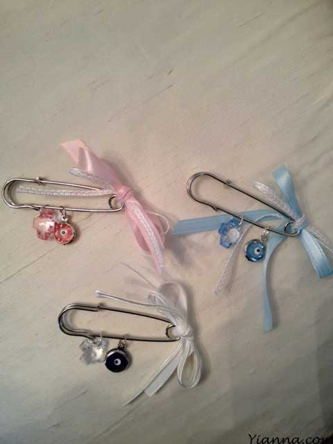 """Pin with cross and mati. "" martyrika  Safety pin 1 1/2"" with acrylic cross , mati  Choices cross : clear , pink, blue Mati: pink , blue, navy Ribbon: white , pink , blue or any custom color . Please specify during checkout $1.50each Add personalization $.50"