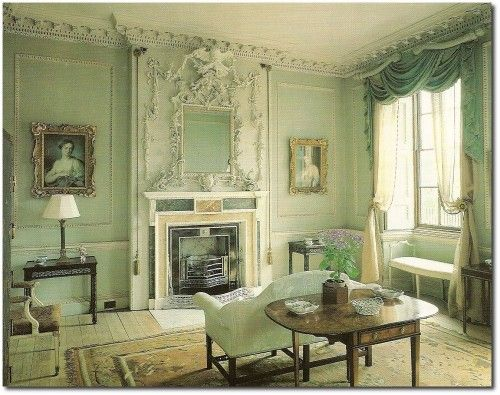 This is another image influenced by Neoclassical interior with english style furniture and interior colors. The detailing on the wall gives away a classic style in a grand statement which was what neoclassical style was all about. Sofas and chairs were supposed to resemble thrones and the geometric shapes and curves were always used.