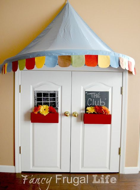 Under the Stairs Closet turned Kids Book Nook - I actually have this canopy from IKEA & I have the Dr. Seuss bags from the Dollar Tree, too!!