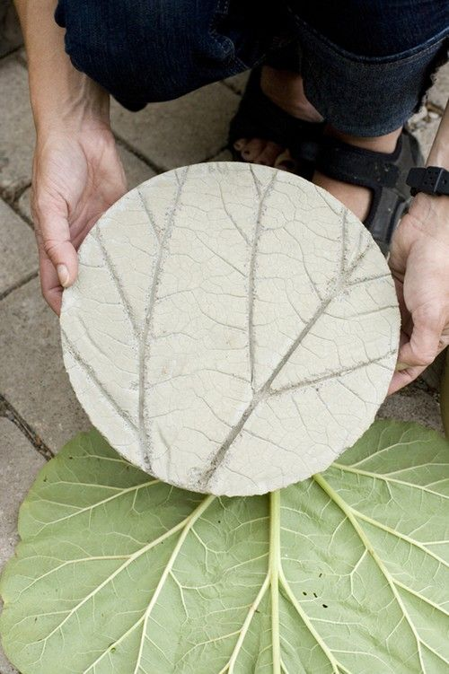 "DIY ""Rhubarb stepping stones anyone? I love the idea of this project. Using some cement, a circular mold and a giant leaf from a rhubarb plant, you can make these cool stepping stones. Now granted, the original blog post is in Swedish but most browsers have translators built into them these days. Her pictures are pretty self explanatory too. So check it out and make some for your garden!"""