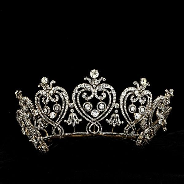 The Manchester tiara of graduated flaming hearts and C scrolls, diamonds set in gold and silver (altho' the C scroll at each end is paste). Louis Cartier, Paris, 1903.   Consuelo, Duchess of Manchester, was a prominent American heiress who married into the British nobility in 1876. The Duke of Portland recorded that she 'took Society completely by storm by her beauty, wit and vivacity and it was soon at her very pretty feet.'