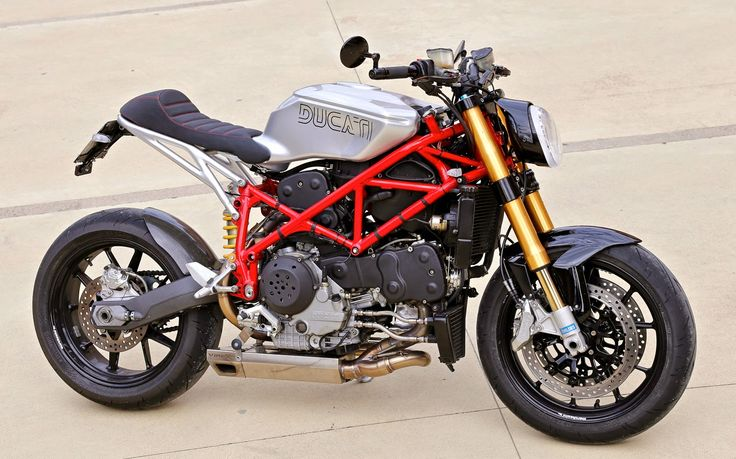 "2004 Ducati 999S Cafe Racer Ducati Cafe Racer based on a 2004 Ducati 999S. This Ducati 999S Cafe Racer is named Red Devil 999 by Claudio Zanotto.  Ducati 999S Cafe Racer features Ducati cafe racer seat Custom Cafe racer clip-on handle bars Ducati Exhaust by Virex. 2004 Ducati 999S Cafe Racer ""Red devil 999"" was a One of the attractive contestants at the Sun Ride icon award."