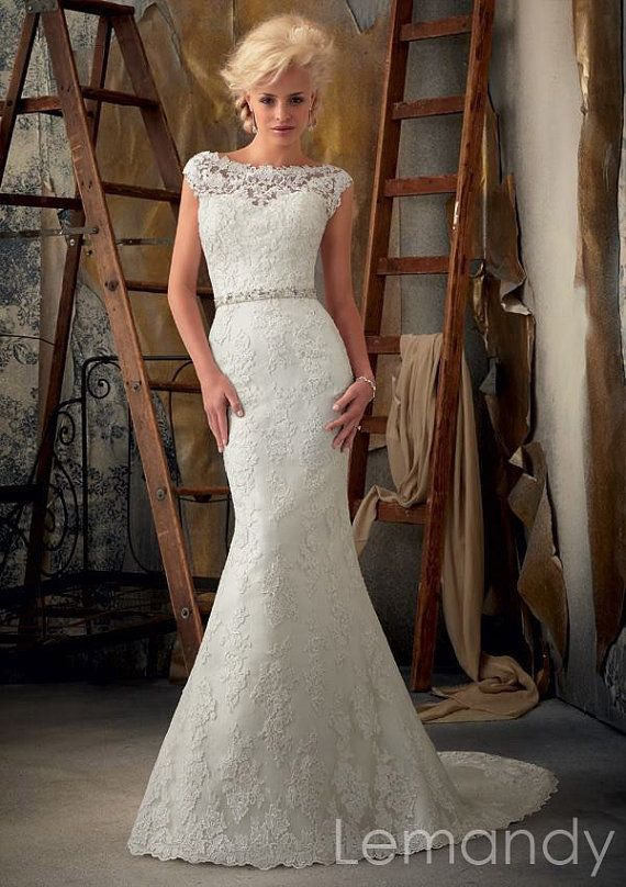 cap sleeves scoop mermaid lace wedding gown V back with sash. $298.00, via Etsy.