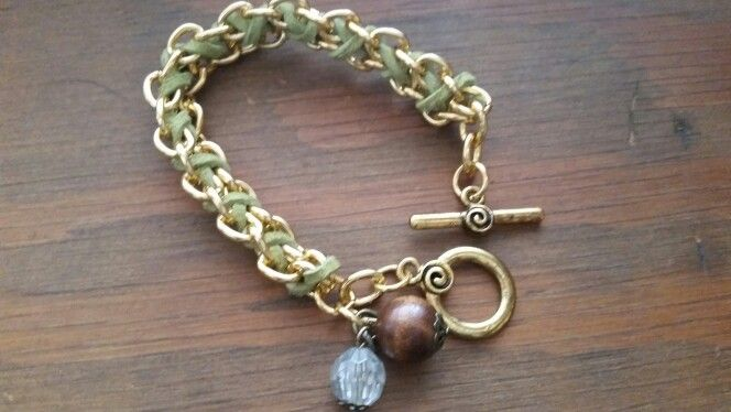 Charm Bracelet. A Green Cord Woven Into a Gold Plated Chain.  https://www.etsy.com/ca/listing/218375049/cord-woven-gold-chain-charm-bracelet?